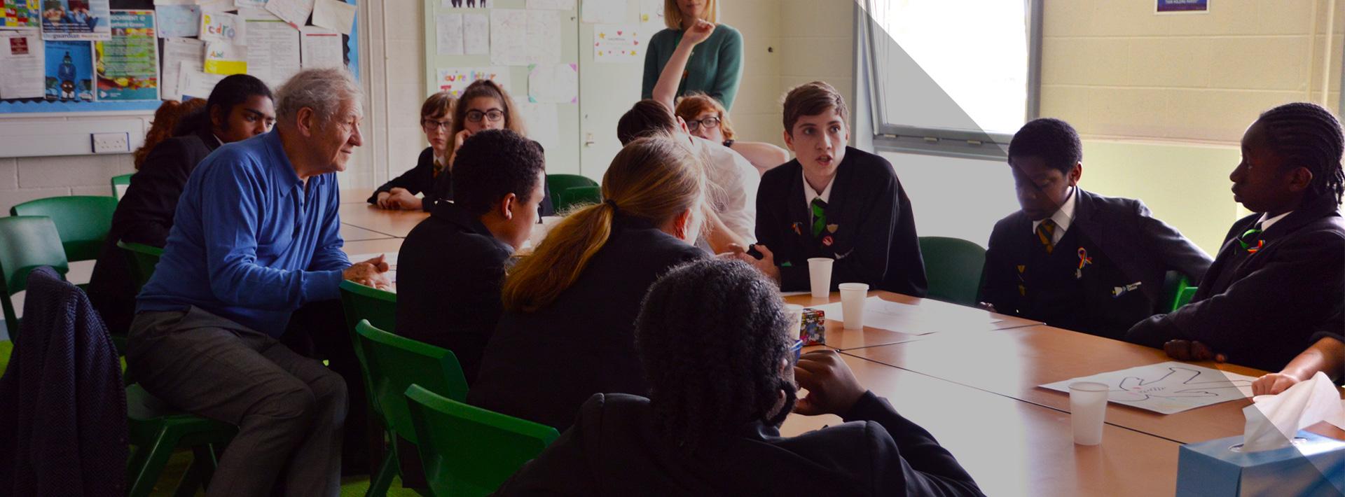 Group of school children with Ian McKellan