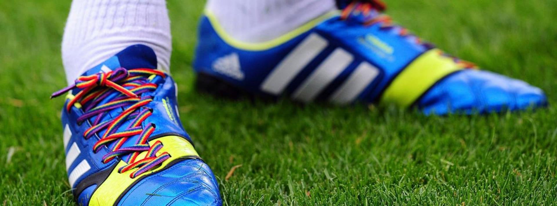 Football boot with rainbow laces