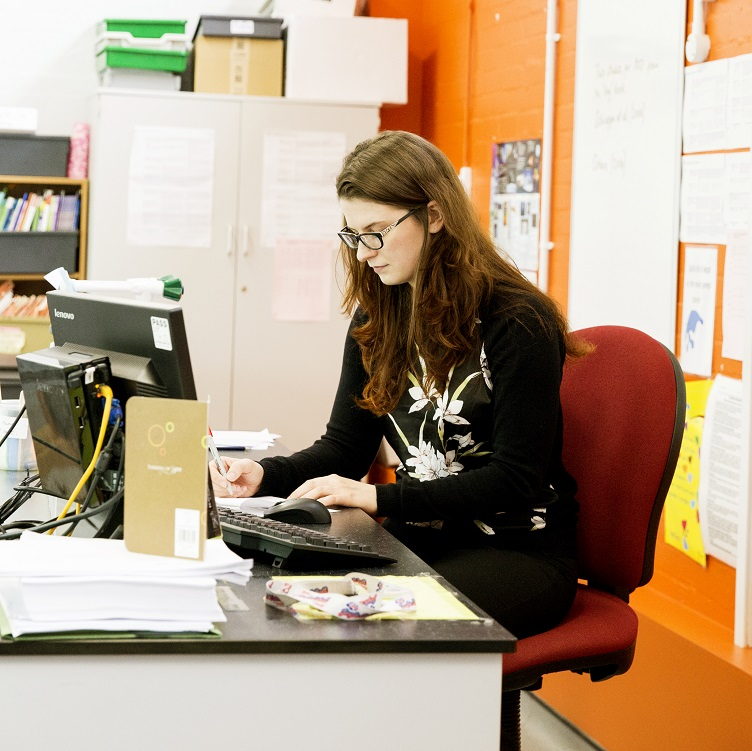 School teacher sitting at the desk