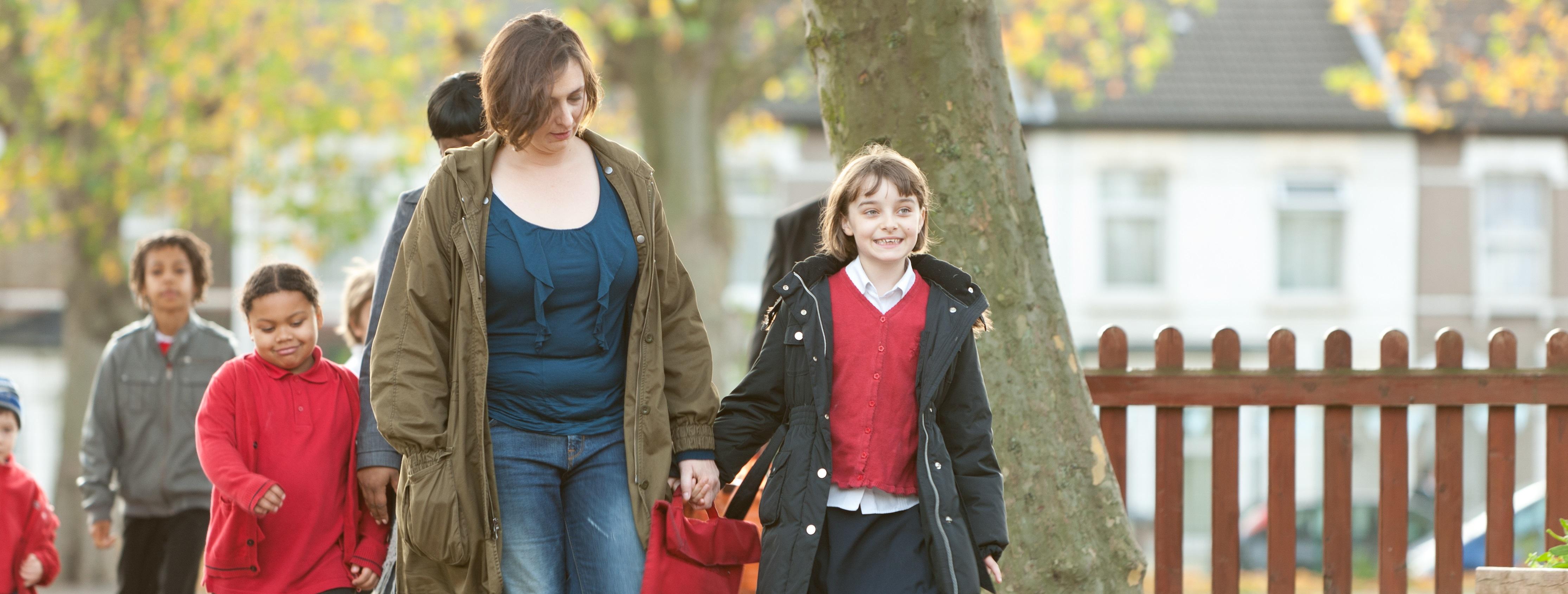 Parents walking their children into school
