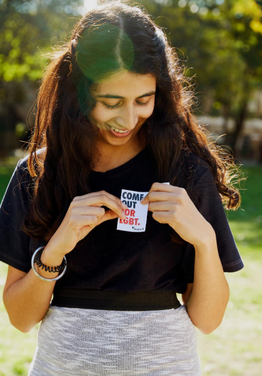 Photo of a woman putting a stonewall sticker on