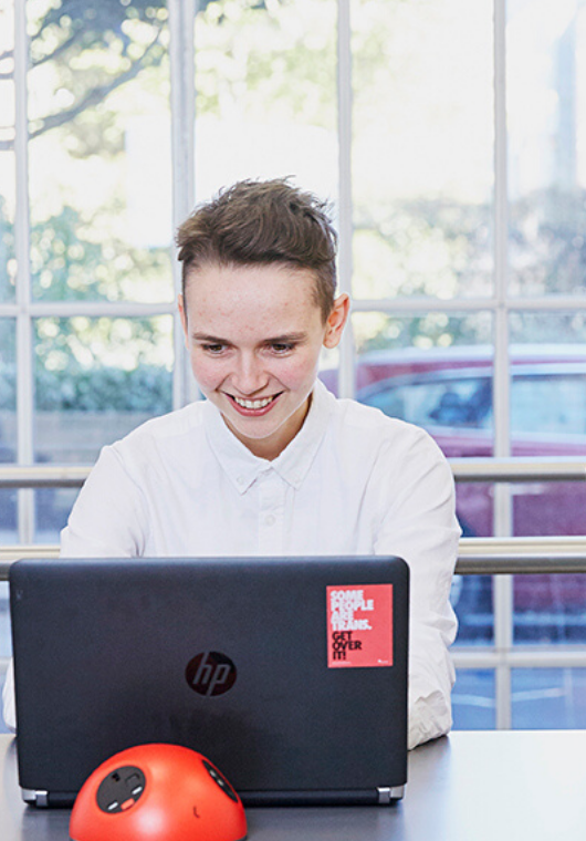 Young person working on a laptop