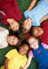 A group of children lying in a circle