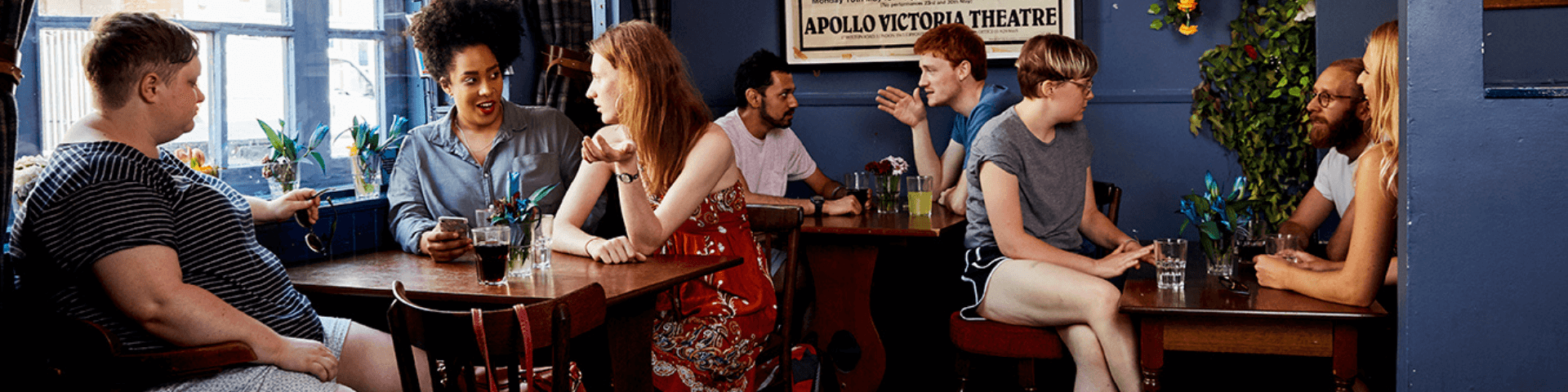 Group of people sitting together in a pub